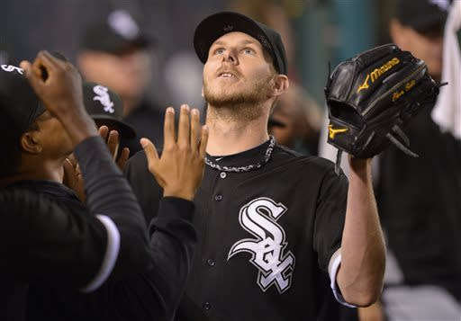 Chicago White Sox starting pitcher Chris Sale (49) is greeted by teammates after leaving the game in the eighth inning of a baseball game against the Los Angeles Angels, Friday, May 17, 2013 in Anaheim, Calif. Sale struck out 12 batters in 7 and two thirds innings. (AP Photo/Mark J. Terrill)