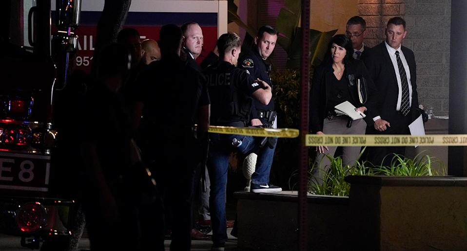 nvestigators gather outside an office building where a shooting occurred in Orange, Calif., Wednesday, March 31, 2021. Source: AP Photo/Jae C. Hong via AAP