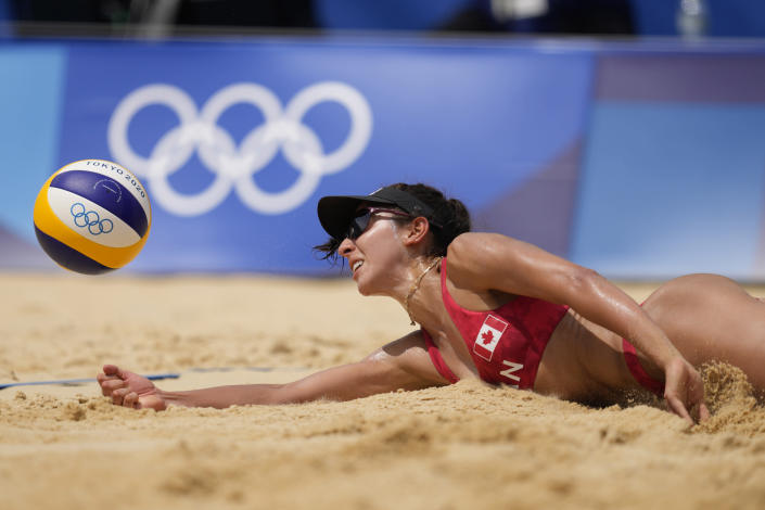 Melissa Humana-Paredes, of Canada digs out the ball during a women's beach volleyball match against Spain at the 2020 Summer Olympics, Monday, Aug. 2, 2021, in Tokyo, Japan. (AP Photo/Petros Giannakouris)