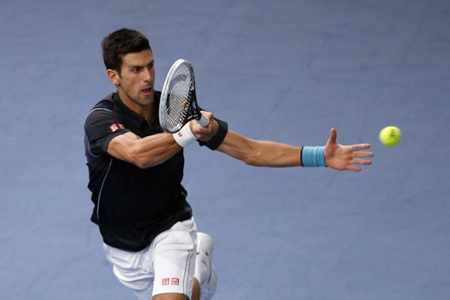 Novak Djokovic of Serbia returns the ball to David Ferrer of Spain during their final match, at the Paris Masters tennis at Bercy Arena in Paris, France, Sunday, Nov. 3, 2013. (AP Photo/Francois Mori)