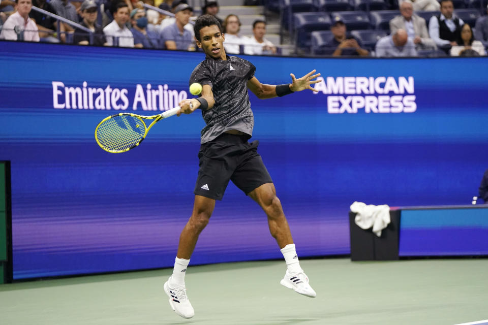 Felix Auger-Aliassime, of Canada, hits a forehand to Carlos Alcaraz, of Spain, during the quarterfinals of the U.S. Open tennis tournament Tuesday, Sept. 7, 2021, in New York. (AP Photo/Frank Franklin II)