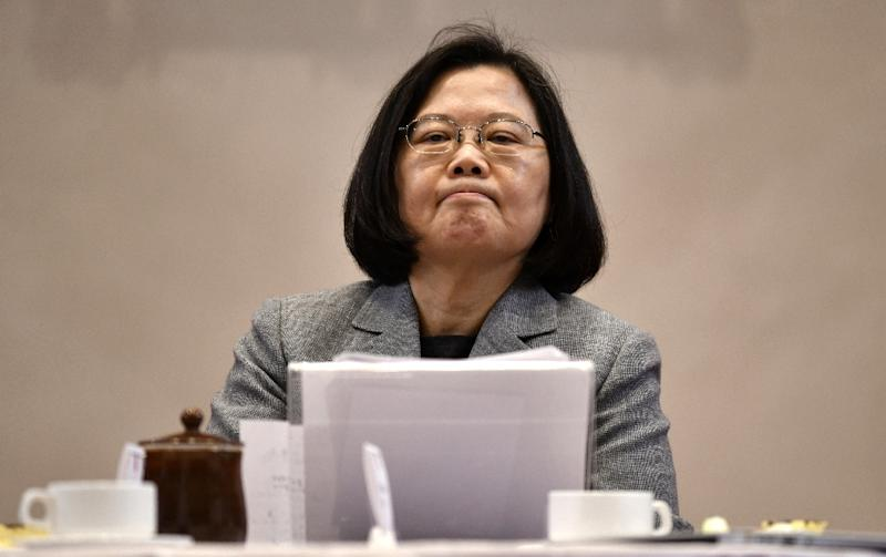 Tsai Ing-wen resigned her party's chairmanship after bruising poll defeats but stayed on as Taiwan's president (AFP Photo/Sam YEH)