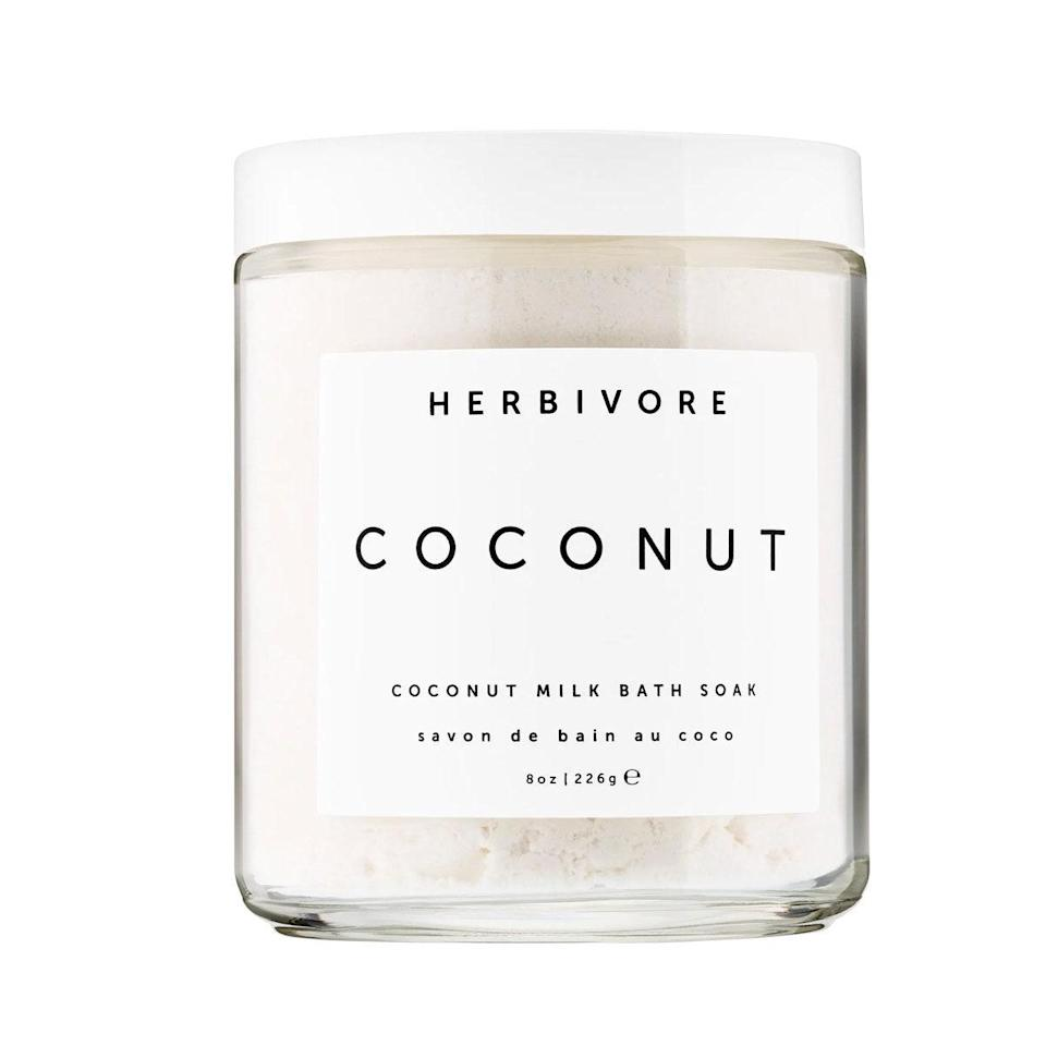 """Let me preface this by saying I'm generally not a coconut fan. I find the scent too pungent—or if it's mixed with something tropical, too cloying. This sugar scrub isn't either of those. The scent is sweet, but subtle, like you just cracked open a coconut straight from the tree. The scrub itself is thick and satisfying to dip your hand into, and glides smoothly over your skin without ever feeling too rough or oily. I love it. <em>—L.S.</em> $18, Herbivore. <a href=""""https://shop-links.co/1726639492813410300"""" rel=""""nofollow noopener"""" target=""""_blank"""" data-ylk=""""slk:Get it now!"""" class=""""link rapid-noclick-resp"""">Get it now!</a>"""