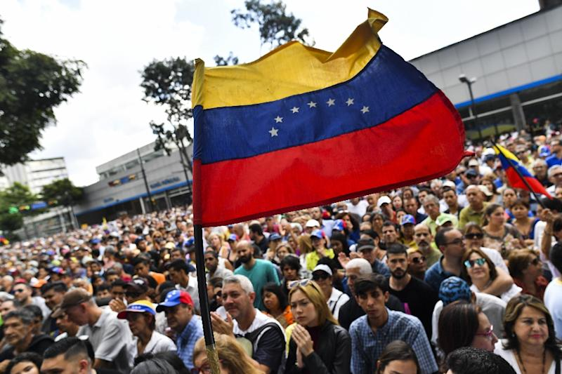Anti-government activists listen to the president of Venezuela's opposition-led National Assembly Juan Guaido in Caracas on January 11, 2019