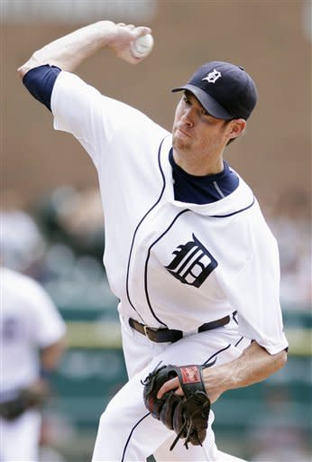 Detroit Tigers starter Doug Fister pitches against the Baltimore Orioles in the first inning of a baseball game on Sunday, Aug. 19, 2012, in Detroit. (AP Photo/Duane Burleson)