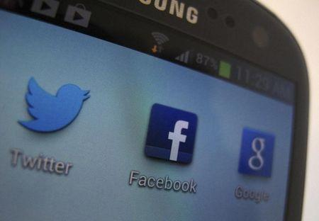 A Facebook icon is shown on a Samsung Galaxy III mobile phone in this photo illustration in Encinitas, California