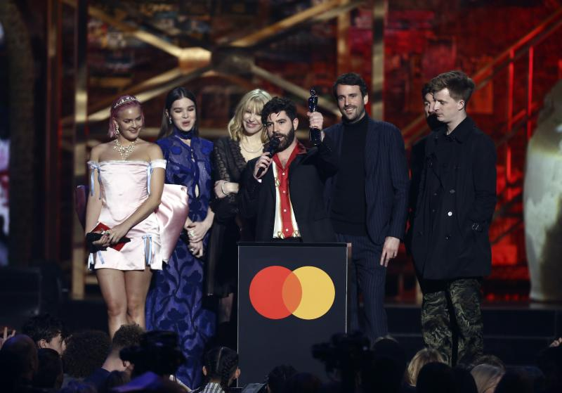 Foals accept their award for British Group on stage at the Brit Awards 2020 in London, Tuesday, Feb. 18, 2020. (Photo by Joel C Ryan/Invision/AP)