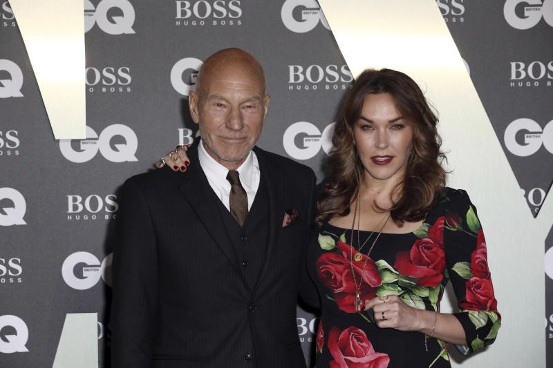 Actor Sir Patrick Stewart and his wife Sunny Ozell pose for photographers on arrival at the GQ Men of the year Awards in central London on Tuesday, Sept. 3, 2019. (Photo by Grant Pollard/Invision/AP)