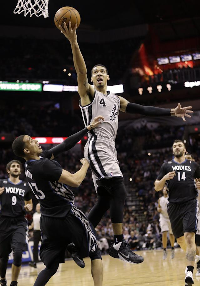 San Antonio Spurs' Danny Green (4) shoots over Minnesota Timberwolves' Kevin Martin (23) during the first half on an NBA basketball game, Sunday, Jan. 12, 2014, in San Antonio. (AP Photo/Eric Gay)