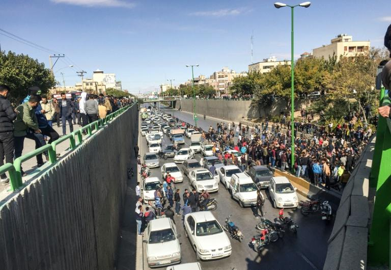 Iranian protesters blocked major roads during demonstrations, which prompted authorities to cut internet access to stop images being released around the world (AFP Photo/-)
