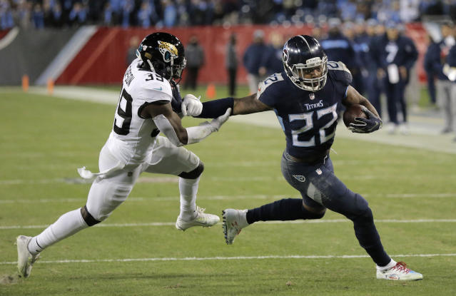 Tennessee Titans running back Derrick Henry (22) runs against Jacksonville Jaguars free safety Tashaun Gipson (39) during the second half of an NFL football game, Thursday, Dec. 6, 2018, in Nashville, Tenn. The Tennessee Titans won 30-9. (AP Photo/James Kenney)