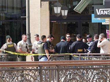 Law enforcement officers work in The Oaks mall in Thousand Oaks, Calif., about 40 miles (64 kilometers) west of Los Angeles on Saturday. AP