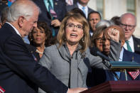 FILE - In this Wednesday, Oct. 4, 2017, file photo, former U.S. Rep. Gabby Giffords, of Arizona, joins other Democrats in a call for action on gun safety legislation on the House steps at the Capitol in Washington. As a mob laid siege to the U.S. Capitol this week, former Rep. Gabby Giffords could only wait nervously for news about her husband, Mark Kelly, who was barely a month into his job as a newly elected senator from Arizona. A decade earlier it was Kelly enduring the excruciating wait for news about Giffords, who was shot in the head in an attempted assassination that, like Wednesday's siege, shocked the nation and prompted a reckoning about the state of politics and discourse in the United States. (AP Photo/J. Scott Applewhite, File)