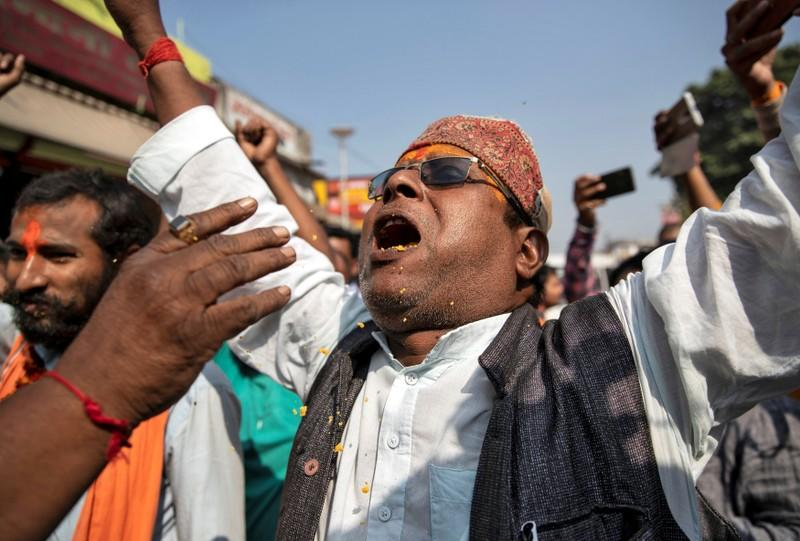 A Hindu devotee celebrates after Supreme Court's verdict on a disputed religious site, in Ayodhya
