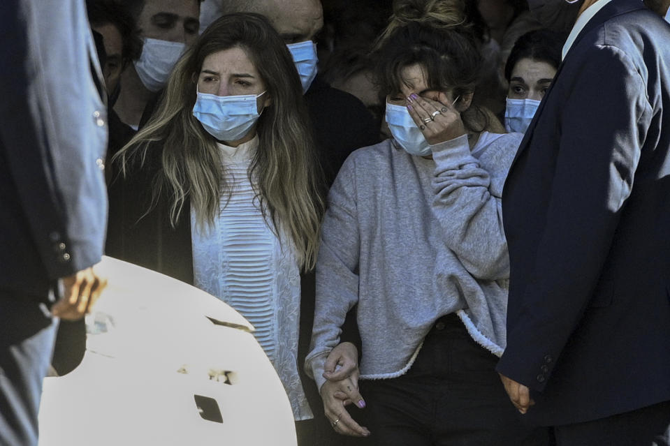 The daughters of the late Argentine football legend Diego Maradona, Dalma (L) and Giannina, leave the Casa Rosada presidential palace at the end of the wake in Buenos Aires on November 26, 2020.