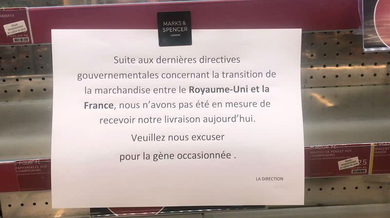 A sign on empty shelves at a Marks&Spencer store in Paris