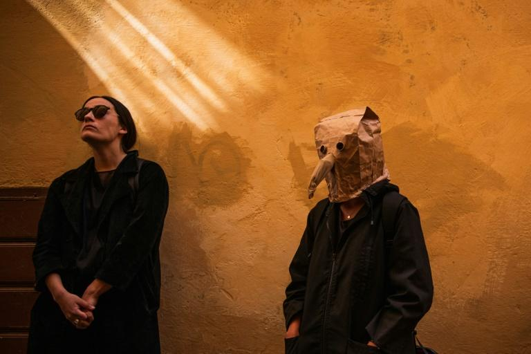 One visitor fashioned a replica of a mask worn by plague doctors in the Middle Ages from a paper bag (AFP Photo/Jonathan NACKSTRAND)