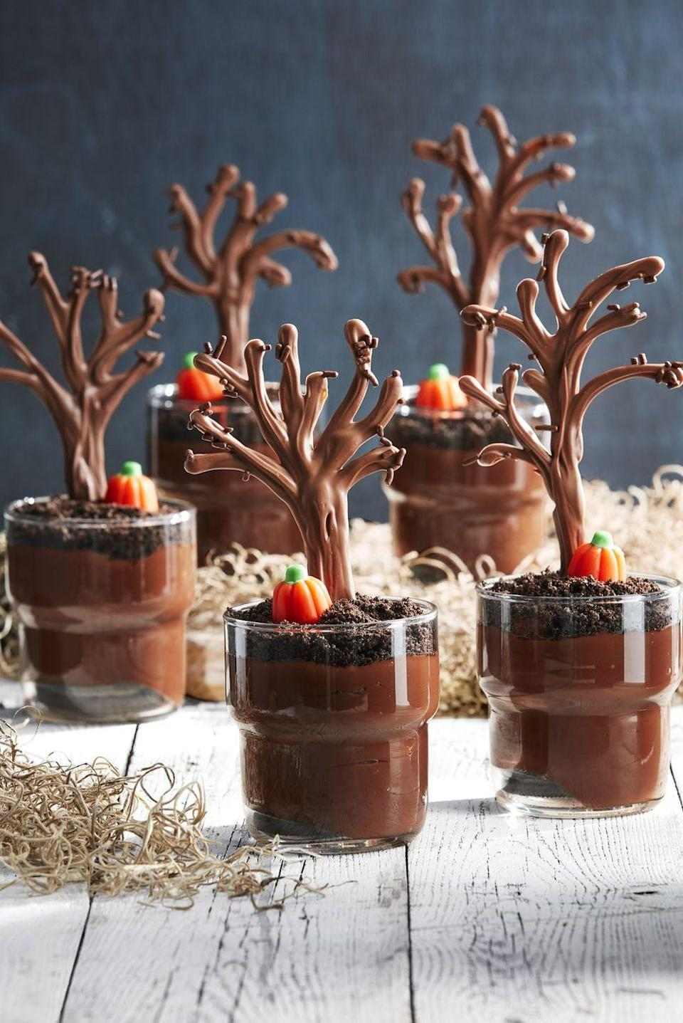 """<p>Chocolate trees and candy pumpkins add Halloween vibes to pudding cups.</p><p><em><a href=""""https://www.countryliving.com/food-drinks/a28943384/spooky-forest-pudding-cups/"""" rel=""""nofollow noopener"""" target=""""_blank"""" data-ylk=""""slk:Get the recipe from Country Living »"""" class=""""link rapid-noclick-resp"""">Get the recipe from Country Living »</a></em></p>"""