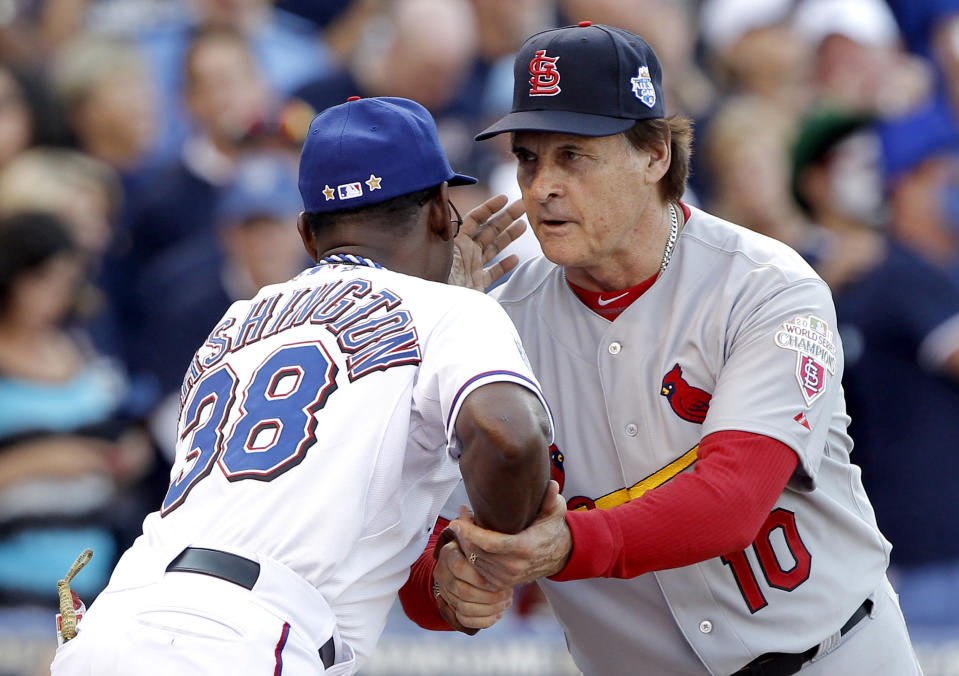 American League manager Ron Washington shakes hands at home plate with National League manager Tony La Russa (10) before the MLB All-Star Game on Tuesday, July 10, 2012, at Kauffman Stadium in Kansas City, Missouri. (John Sleezer/Kansas City Star/Tribune News Service via Getty Images)