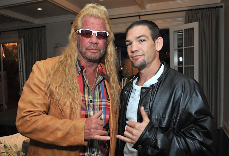 LOS ANGELES, CA - DECEMBER 12: Dog Chapman and Leland Chapman attend the 2013 Electus & College Humor Holiday Party at a private residency on December 12, 2013 in Los Angeles, California. (Photo by Angela Weiss/Getty Images for Electus)