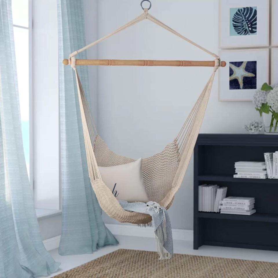 """Not only will this add a boho-chic vibe to the room, buit will be the perfect place to relax and finish that book everyone was talking about last year.<br /><br /><strong>Promising review:</strong>""""My girls thought these were the coolest chairs ever. We purchased the chairs for them, but they hold me and my husband just as comfortably.<strong>They're perfect for everybody.</strong>I highly recommend them!"""" —Lacey<br /><br /><strong>Get it from Wayfair for<a href=""""https://go.skimresources.com?id=38395X987171&xs=1&url=https%3A%2F%2Fwww.wayfair.com%2Foutdoor%2Fpdp%2Fbeachcrest-home-crowell-chair-hammock-bchh7515.html&xcust=HPHomeMagazine609acebfe4b099ba752f64c2"""" target=""""_blank"""" rel=""""nofollow noopener noreferrer"""" data-skimlinks-tracking=""""5854435"""" data-vars-affiliate=""""CJ"""" data-vars-campaign=""""SHOPMagazineHomeMower2-2-2021--5854435-/https://www.wayfair.com/outdoor/pdp/beachcrest-home-crowell-chair-hammock-bchh7515.html"""" data-vars-href=""""https://www.anrdoezrs.net/links/8209452/type/dlg/sid/SHOPMagazineHomeMower2-2-2021--5854435-/https://www.wayfair.com/outdoor/pdp/beachcrest-home-crowell-chair-hammock-bchh7515.html"""" data-vars-link-id=""""16331203"""" data-vars-price="""""""" data-vars-product-id=""""20945784"""" data-vars-product-img=""""https://secure.img1-fg.wfcdn.com/im/94722356/resize-h800-w800%5Ecompr-r85/4770/47701514/Crowell+Chair+Hammock.jpg"""" data-vars-product-title=""""Crowell Chair Hammock"""" data-vars-redirecturl=""""https://www.wayfair.com/outdoor/pdp/beachcrest-home-crowell-chair-hammock-bchh7515.html"""" data-vars-retailers=""""wayfair"""" data-ml-dynamic=""""true"""" data-ml-dynamic-type=""""sl"""" data-orig-url=""""https://www.anrdoezrs.net/links/8209452/type/dlg/sid/SHOPMagazineHomeMower2-2-2021--5854435-/https://www.wayfair.com/outdoor/pdp/beachcrest-home-crowell-chair-hammock-bchh7515.html"""" data-ml-id=""""5"""">$53.99</a>.</strong>"""