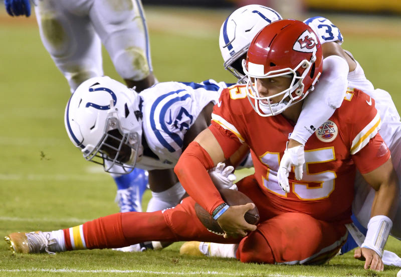 Indianapolis Colts defensive end Kemoko Turay (57) and Indianapolis Colts safety Khari Willis (37) wrap-up Kansas City Chiefs quarterback Patrick Mahomes (15) after Mahomes scrambled for a first down in the fourth quarter on Sunday, Oct. 6, 2019 at Arrowhead Stadium in Kansas City, Mo. (Rich Sugg/Kansas City Star/Tribune News Service via Getty Images)