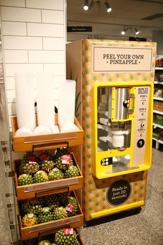 A general view of the pineapple coring machine during the Coles Local St Kilda Store Opening.