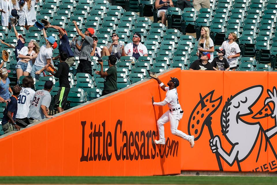 Detroit Tigers center fielder Akil Baddoo (60) jumps up for a foul ball against the Boston Red Sox during the ninth inning at Comerica Park in Detroit, Thursday, Aug. 5, 2021.