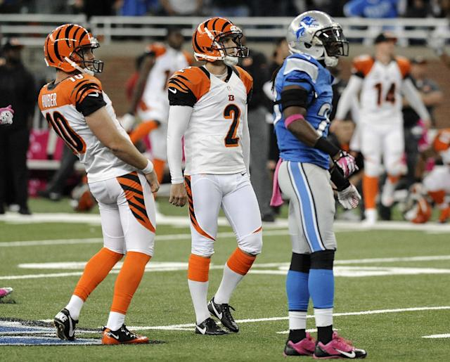 Cincinnati Bengals kicker Mike Nugent (2) watches his game winning 54-yard field goal with Kevin Huber (10) and Detroit Lions' Louis Delmas (26) in the fourth quarter of an NFL football game Sunday, Oct. 20, 2013, in Detroit. Cincinnati beat Detroit 27-24. (AP Photo/Jose Juarez)