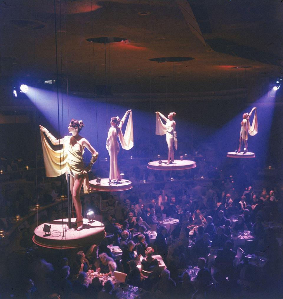 <p>The Bluebell Girls pose on aerial platforms at the Stardust Hotel. This well-known group typically performed at the Lido Nightclub in Paris, France, but journeyed to Las Vegas in 1958. </p>