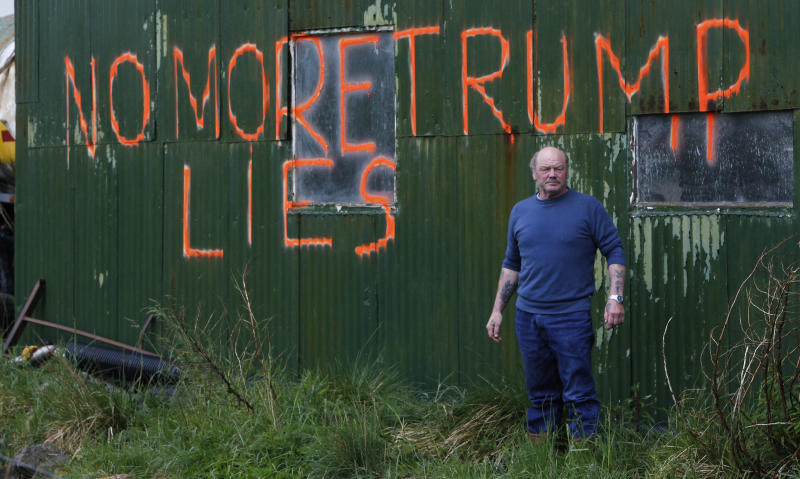 Scottish quarry worker Michael Forbes poses for a photograph by the side of a building on his property near Aberdeen, north east Scotland May 26, 2010. Forbes opposes U.S. Businessman Donald Trump's golf resort development, and his land sits between the two proposed 18-hole golf courses and a planned 450-bedroom five-star hotel, local media reported. REUTERS/David Moir (BRITAIN - Tags: BUSINESS SPORT GOLF POLITICS SOCIETY)