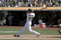 Oakland Athletics' Matt Olson hits a game winning double against the San Diego Padres during the tenth inning of a baseball game in Oakland, Calif., Wednesday, Aug. 4, 2021. (AP Photo/Jed Jacobsohn)