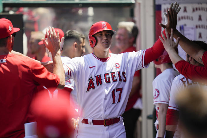 Los Angeles Angels designated hitter Shohei Ohtani (17) celebrates in the dugout with teammates after hitting a home run during the third inning of a baseball game against the Baltimore Orioles Sunday, July 4, 2021, in Anaheim, Calif. (AP Photo/Ashley Landis)