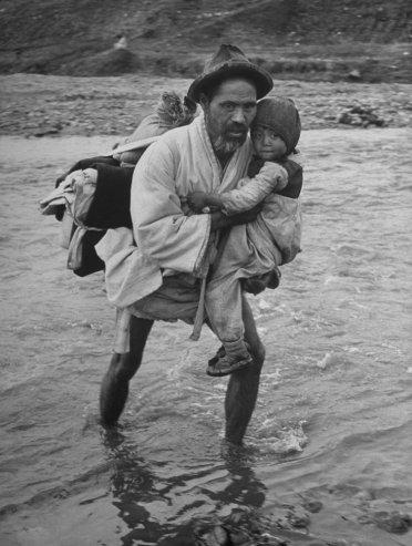 Carl Mydans—Time & Life Pictures/Getty Images Not originally published in LIFE. Refugees cross into South Korea, March, 1951