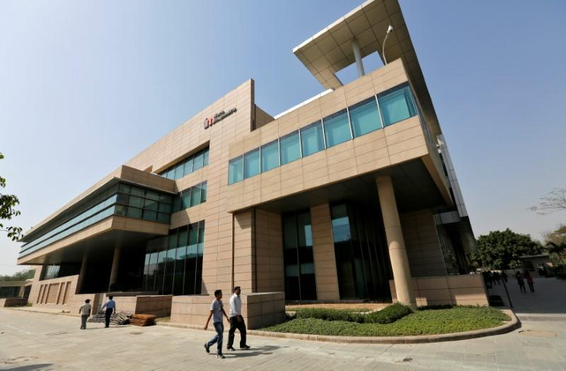 Employees walk inside Tech Mahindra office premises in Noida