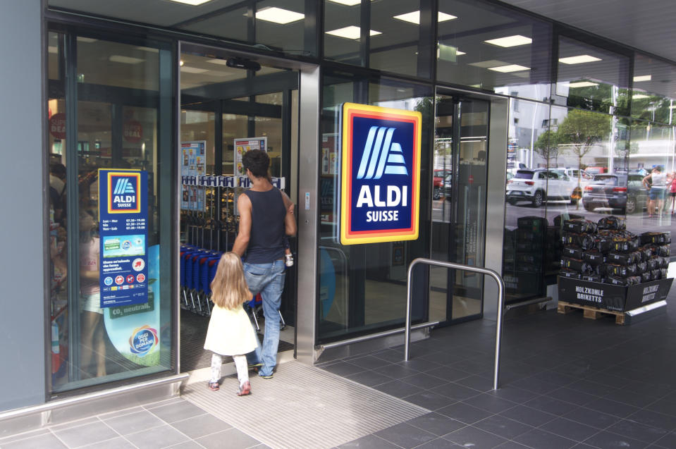 Lugano, Ticino, Switzerland - 19th August 2019 : People entering a Aldi supermarket shop in Switzerland. ALDI is a german company and one of the biggest discount supermarket chains in the world