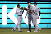 New York Yankees left fielder Greg Allen, left, center fielder Aaron Judge, center, and right fielder Joey Gallo celebrate after the team's 3-1 win in a baseball game against the Miami Marlins, Friday, July 30, 2021, in Miami. (AP Photo/Lynne Sladky)