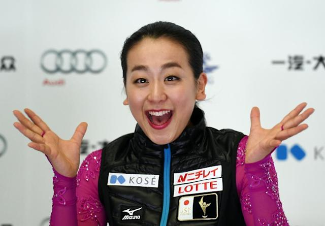 Mao Asada of Japan finished top after the first round of the Cup of China Grand Prix on November 6, 2015 (AFP Photo/Greg Baker)