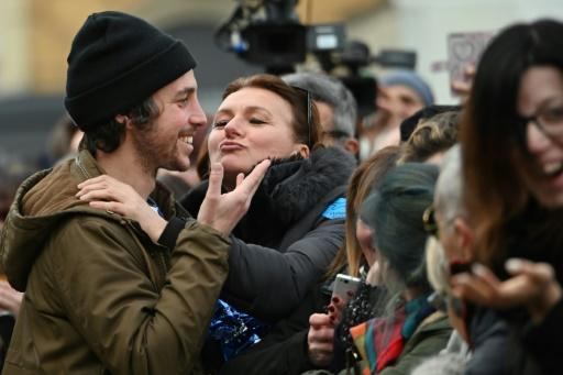 A woman kisses Mattia Santori , one of the founders of the anti-fascist 'Sardine Movement' during a rally this week in Bologna, the capital of Emilia Romagna