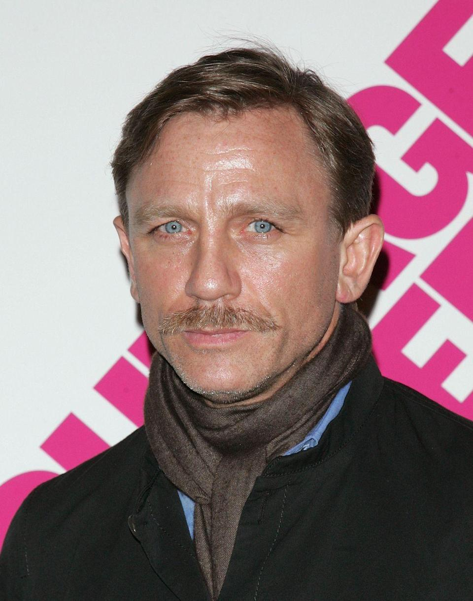 <p>Though he's known for portraying a perpetually clean-shaven James Bond in the 007 franchise, Daniel Craig has also proven that an impeccably trimmed blonde mustache is the perfect complement to his piercing blue eyes. </p>