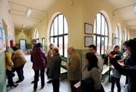 People line up to vote during general election in Seville