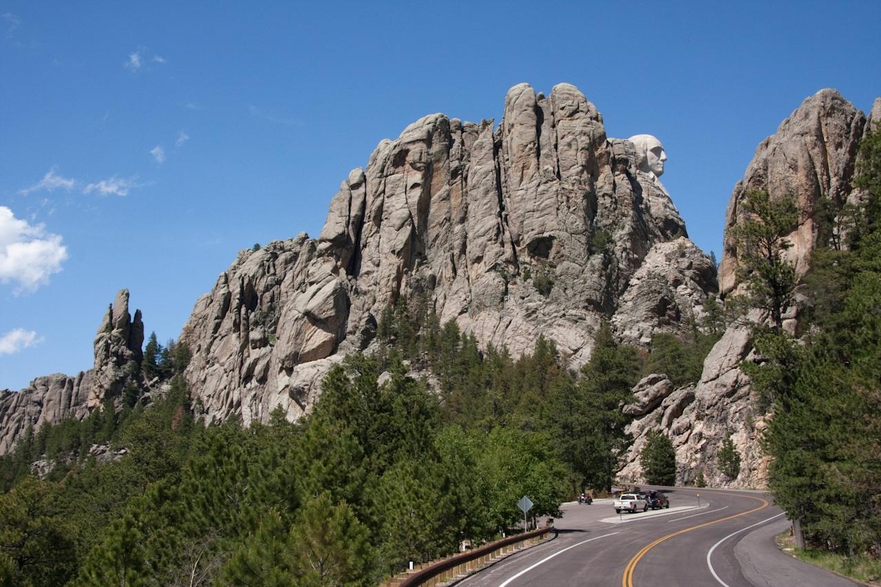 South Dakota's Black Hills might not be the most well-known travel route in the U.S., but that's part of the allure. This region blends history and scenery in a way few others can. And that's because a drive from 1-90, and into the <strong>Badlands Scenic Byway</strong> will take travelers through the stunning cliffs and multi-colored spires of Badlands National Park. Other notable sites in the area? Mount Rushmore (George Washington's profile can be seen in the image above).