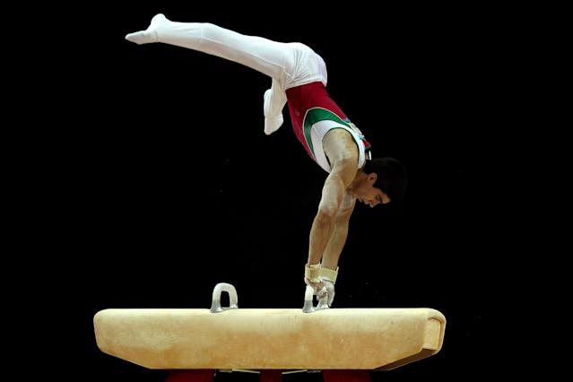 LONDON, ENGLAND - JANUARY 10: Daniel Corral Barron of Mexico in action on the Pommell Horse during day one of the Men's Gymnastics Olympic Qualification round at North Greenwich Arena on January 10, 2012 in London, England. (Photo by Ian Walton/Getty Images)
