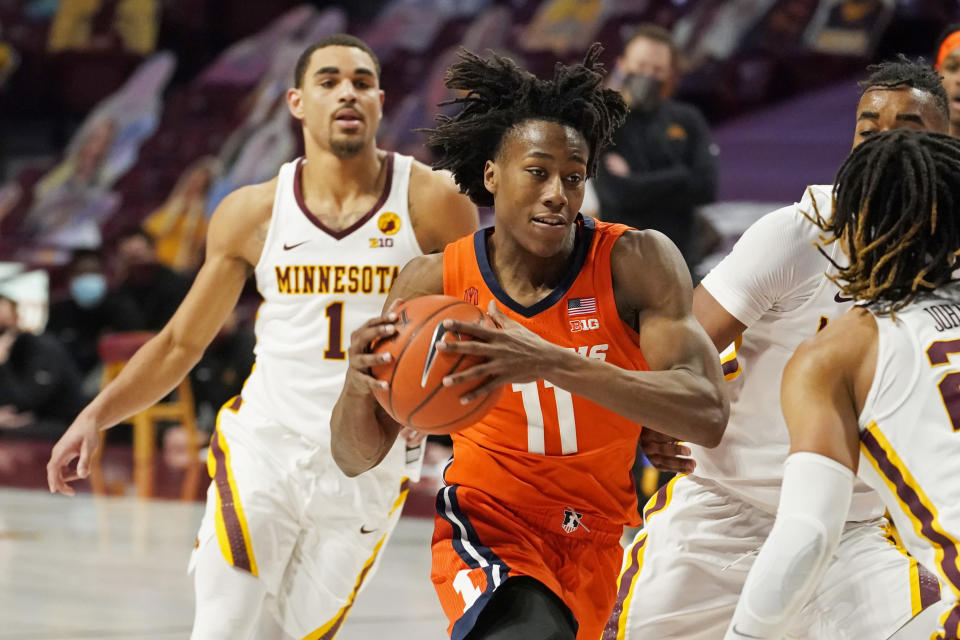 Illinois' Ayo Dosunmu (11) drives past Minnesota's Tre' Williams (1) in the second half of an NCAA college basketball game, Saturday, Feb. 20, 2021, in Minneapolis. Dosunmu scored 19 points. (AP Photo/Jim Mone)