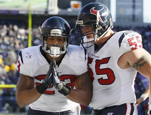 Houston Texans running back Arian Foster, left, reacts to his touchdown as center Chris Myers, right, congratulates him during the first half of an NFL divisional playoff football game against the Baltimore Ravens in Baltimore, Sunday, Jan. 15, 2012. (AP Photo/Patrick Semansky)