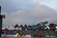 San Francisco Giants' Zack Littell, bottom left, pitches against the Atlanta Braves during the fourth inning of a baseball game in San Francisco, Saturday, Sept. 18, 2021. (AP Photo/Jeff Chiu)
