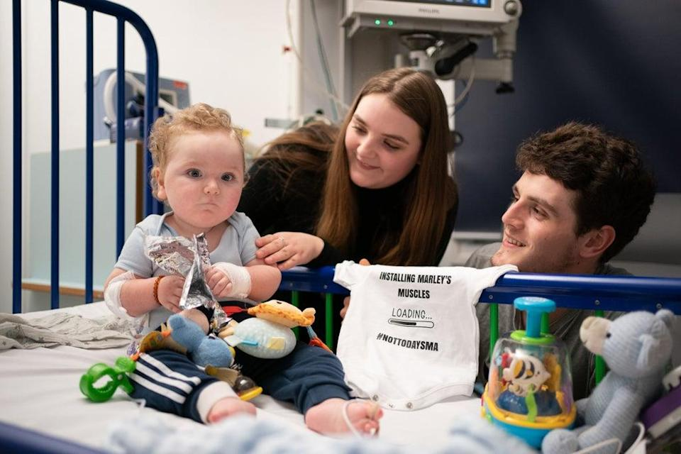 Rosie-Mae Walton and Wes Powell with their son Marley as he recovers at Sheffield Children's Hospital after receiving the ;most expensive drug in the world;, the genetic treatment Zolgensma (Joe Giddens/PA) (PA Wire)