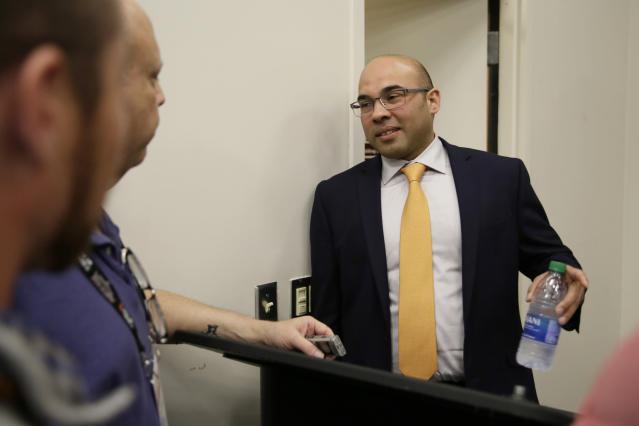 San Francisco Giants President of Baseball Operations Farhan Zaidi talks with reporters after a news conference at Oracle Park, Monday, Nov. 11, 2019, in San Francisco. The Giants hired Scott Harris from the Chicago Cubs to become general manager, filling a void of more than a year after the club had gone without a GM during Zaidi's first season in the position. (AP Photo/Eric Risberg)