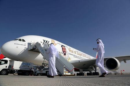Visitors walk next to an Airbus A380, showing a picture of United Arab Emirates's Former President Sheikh Zayed bin Sultan al-Nahayan during the Dubai Airshow in Dubai, United Arab Emirates November 13, 2017. REUTERS/Satish Kumar