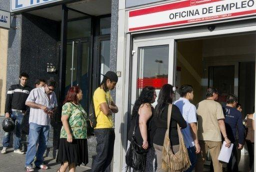 People queue at a government employment office in the centre of Madrid on June 4. The eurozone debt crisis delivered more bad news on Monday with data showing record high unemployment of 11.1 percent and a manufacturing outlook at its lowest levels for three years